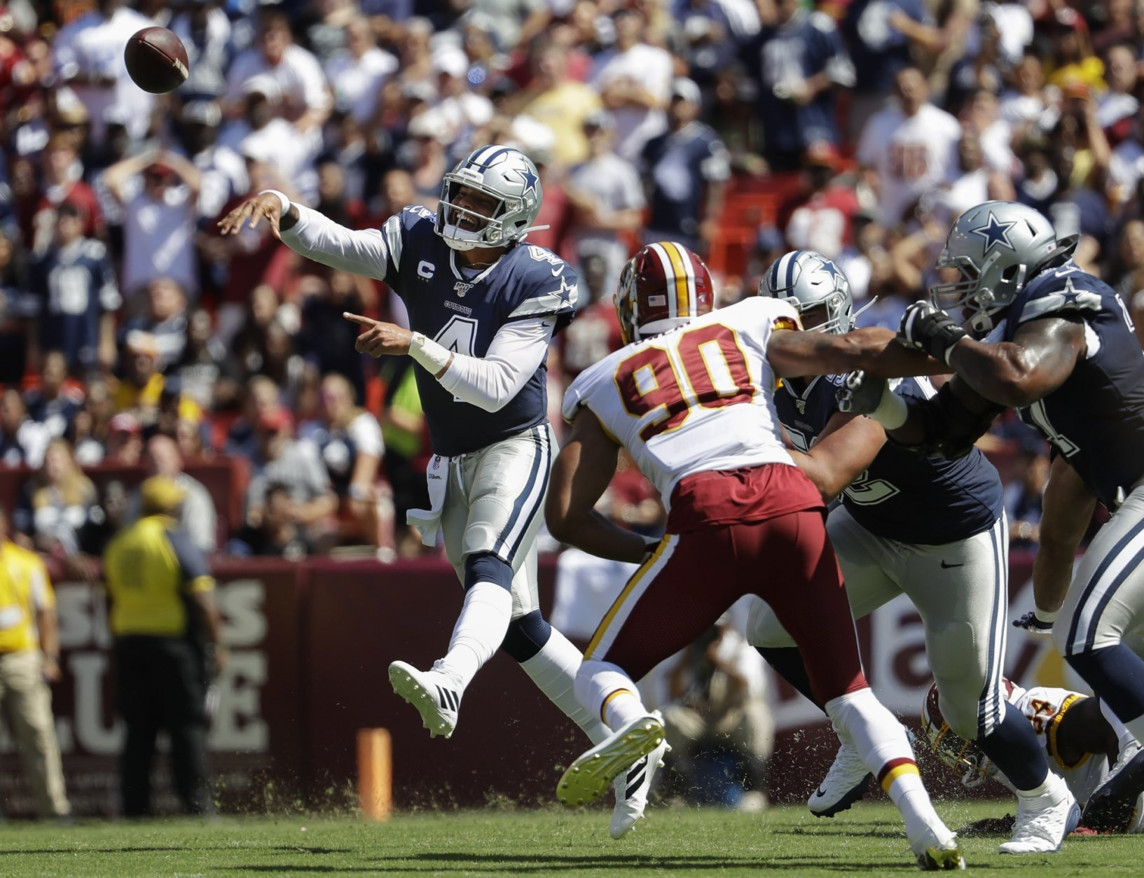 Dak double: Cowboys' Prescott beats Redskins with legs, arm | WTOP