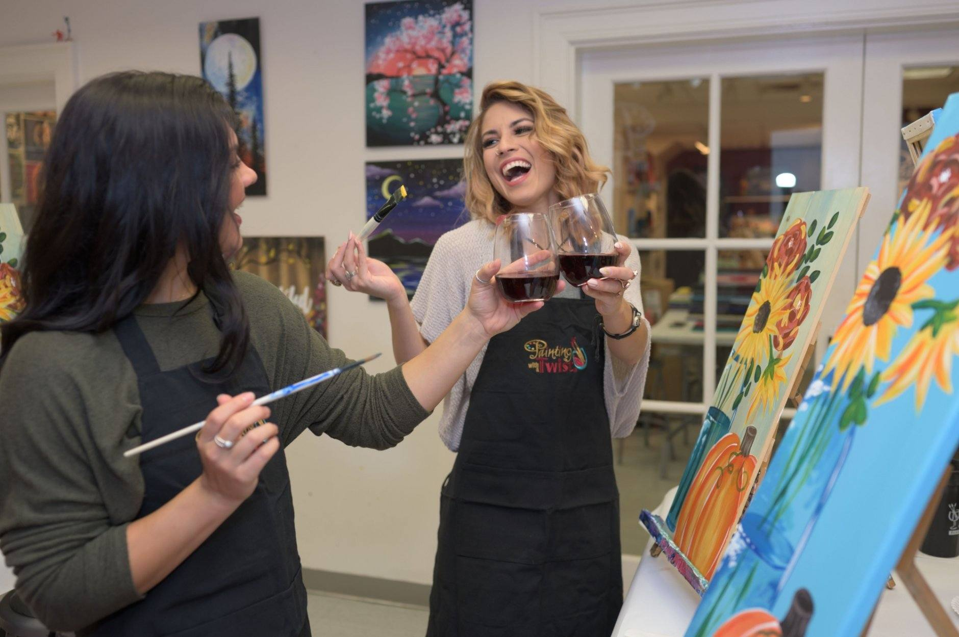 This 2019 photo provided by Painting with a Twist shows some patrons during at a Painting with a Twist event in Mandeville, La. In recent years, the interactive painting industry has become a global sensation. Around the world, adults can spend their nights out learning to paint in a relaxed, BYOB setting. Thousands of franchises exist to help us all unleash our inner creative. (Painting with a Twist via AP)