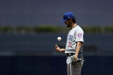 Darvish fans 14, Cubs beat Padres 4-1 to keep wild-card pace