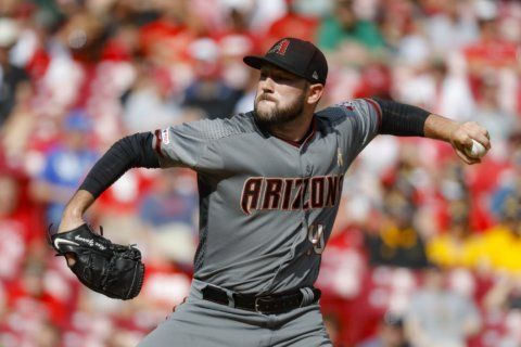 Young, Marte, surging Dbacks top Reds 2-0 for 5th win in row