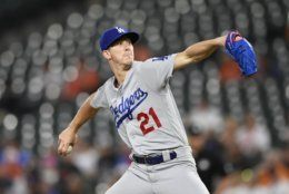 Los Angeles Dodgers starting pitcher Walker Buehler winds up during the first inning of the team's baseball game against the Baltimore Orioles, Tuesday, Sept. 10, 2019, in Baltimore. (AP Photo/Nick Wass)