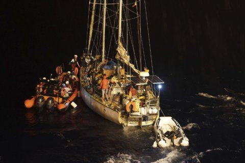 The Latest: Malta lets 5 more refugees in, still blocks ship