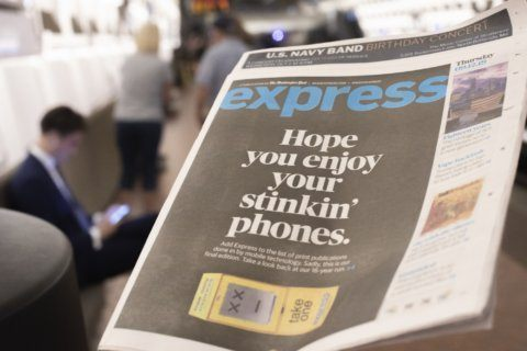 DC's free commuter paper ends run with shot at smart phones