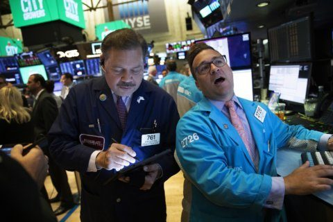 US stocks end mixed following Fed's decision to cut rates