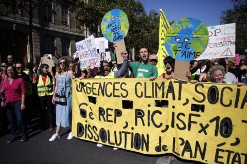 Thousands march in Paris to press for more action on climate