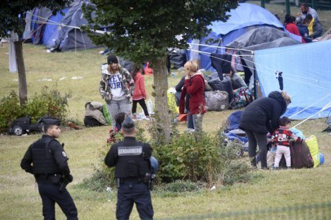 The Latest: Migrant arrivals in EU spike 26% in July