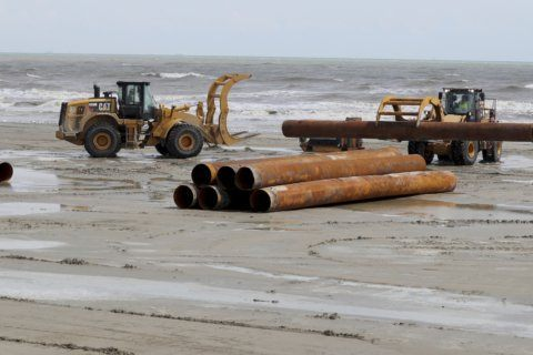 Sand from ship channel dredging improves Galveston beaches