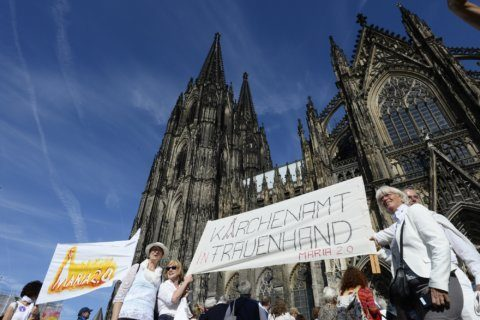 Human chain rings German cathedral to demand gender equality