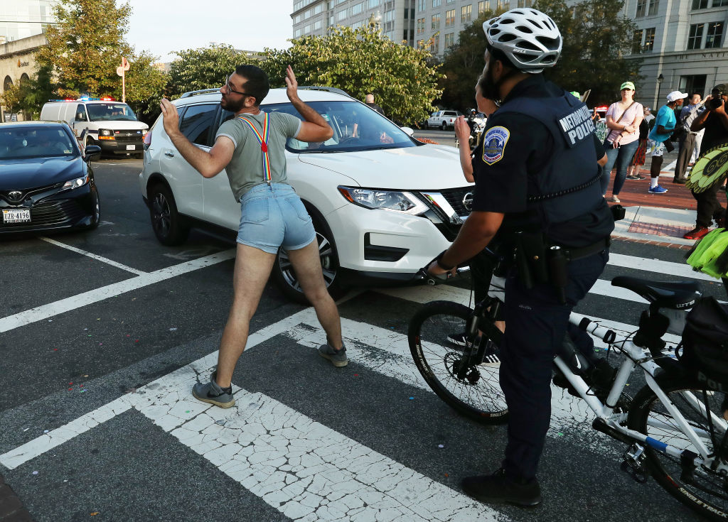 WASHINGTON, DC - SEPTEMBER 23: A climate change protester blocks traffic during a protest to shut down D.C. on September 23, 2019 in Washington, DC. The protesters are urging climate action and want the reallocation of the budget away from the military to fund a Green New Deal.  (Photo by Mark Wilson/Getty Images)