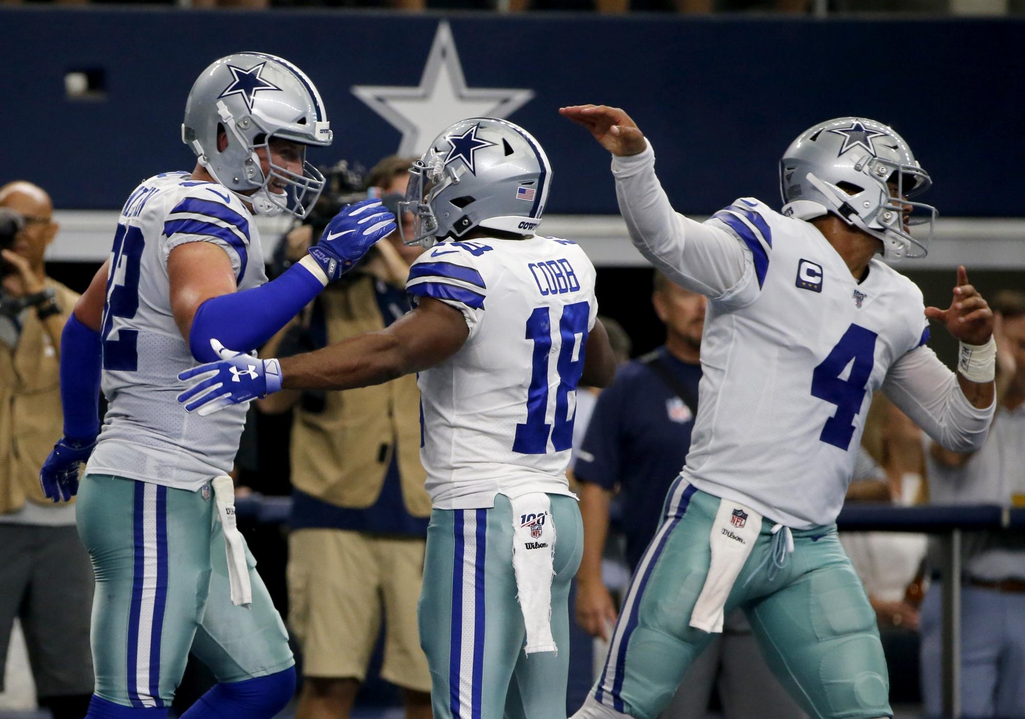 Prescott, play-caller Moore making perfect pair for Cowboys