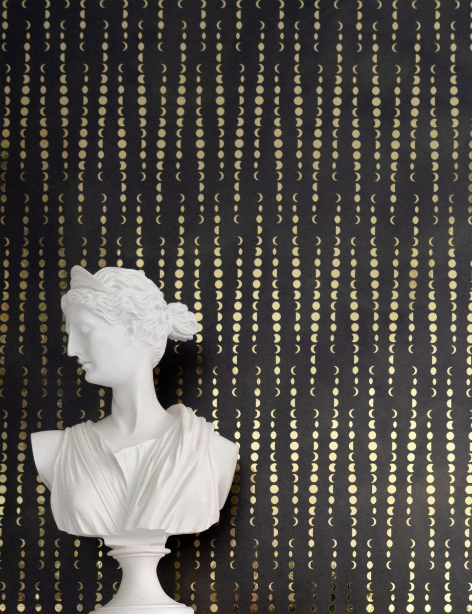 This photo provided by artist Aimee Wilder shows one of her wallpaper designs. Wilder's Eudaimonia collection was named after a Greek word meaning happiness. She was interested in exploring how the celestial bodies over Earth influence us, and the moon's phases are depicted in this Earthlight pattern from the collection. Available in a range of pastels and neutrals, the simple yet artfully-drawn pattern is evocative and compelling, part of the eternal charm of illustrated prints. (Aimee Wilder via AP)