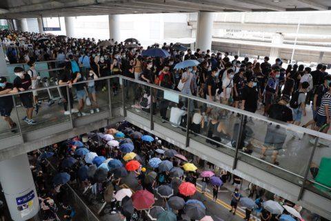 Protests on roads near Hong Kong airport disrupt air travel