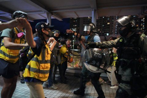 The Latest: Hong Kong protesters block roads near airport