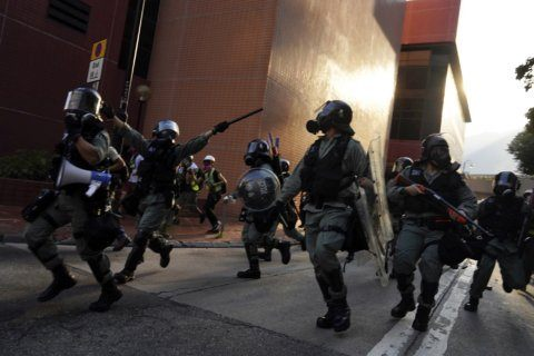 The Latest: Hong Kong police, protesters clash