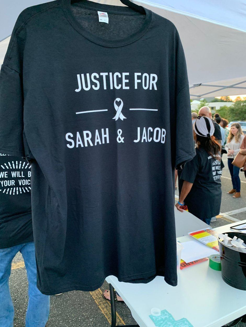 A shirt displayed at the vigil demands answers in the five-year-old case.