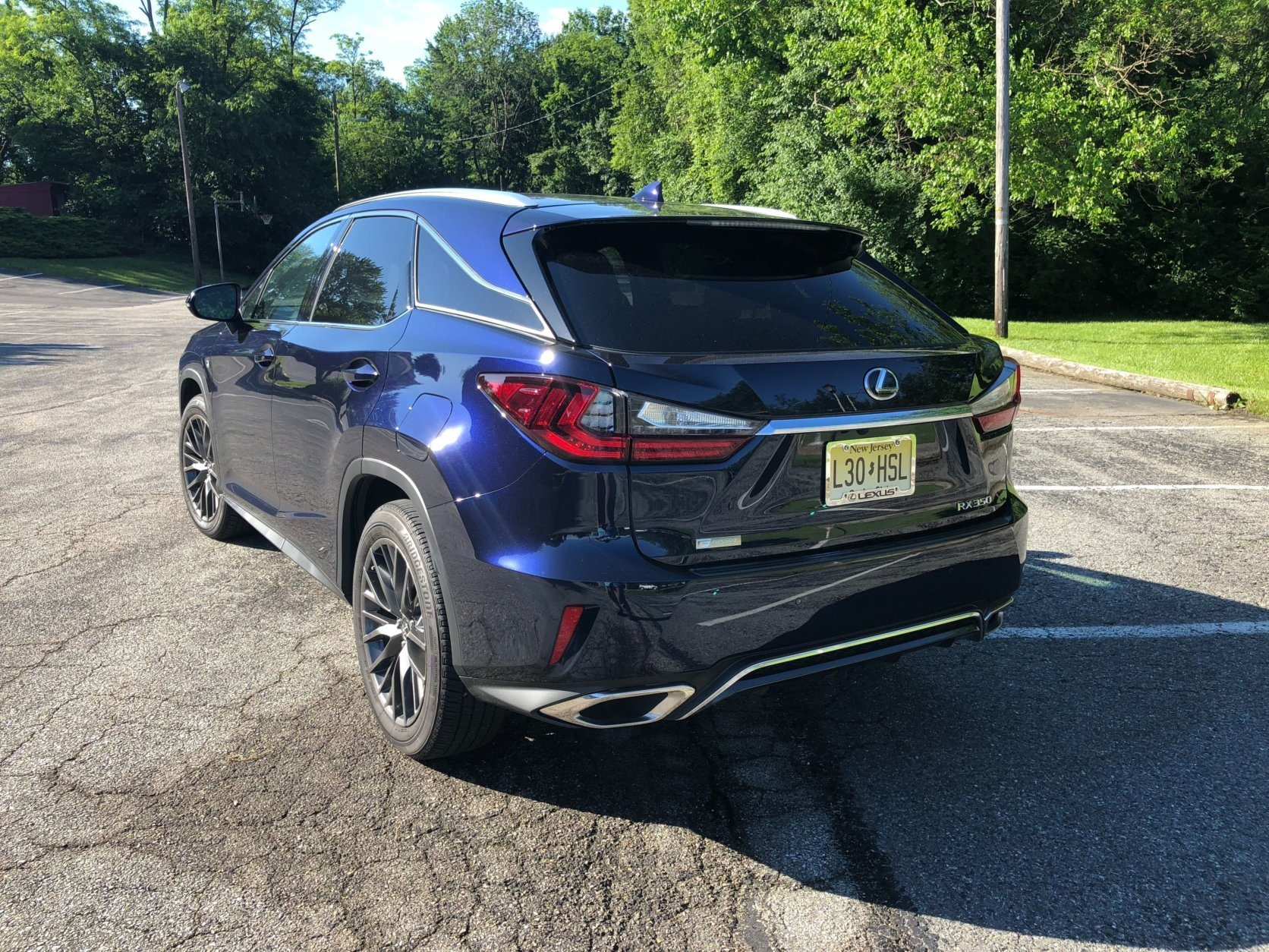 <p>The smaller RX 350 with the F Sport package seems to be a bit quicker than its stretched out counterpart.</p> <p>Dual exhaust outlets add some visual punch.</p>