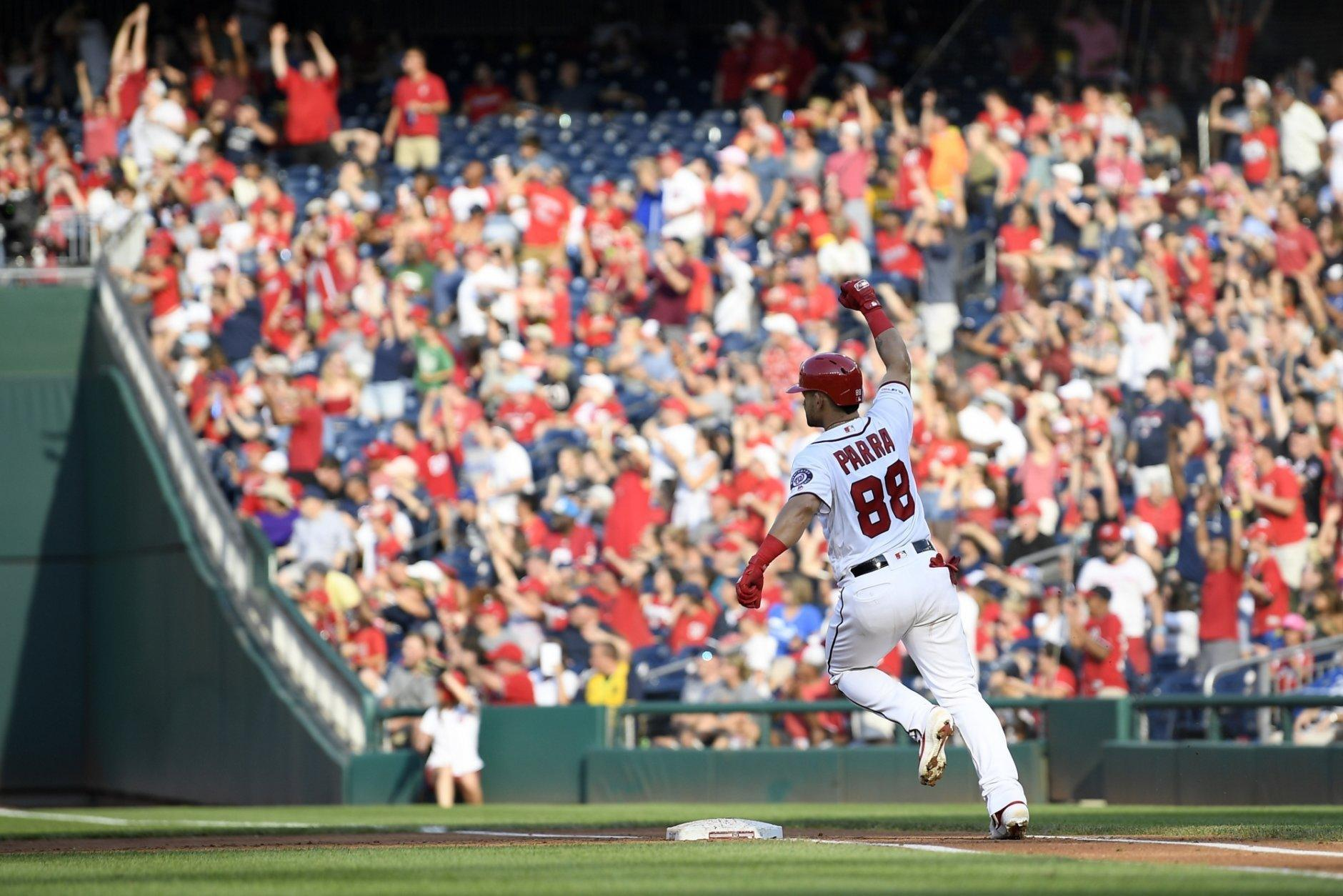 Washington Nationals' Gerardo Parra celebrates his grand slam as he prepares to round first during the second inning of a baseball game against the Cleveland Indians, Saturday, Sept. 28, 2019, in Washington. (AP Photo/Nick Wass)
