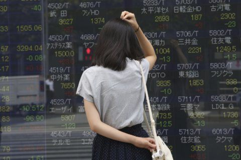 Asian stocks mixed after US, Chinese tariff hikes
