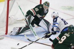 Minnesota Wild goalie Devan Dubnyk (40) makes a save on a shot by Winnipeg Jets forward Mason Appleton (82) in the second period of an NHL hockey game Sunday, Sept. 29, 2019, in St. Paul, Minn. (AP Photo/Andy Clayton-King)