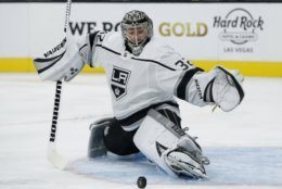Los Angeles Kings goaltender Jonathan Quick blocks a shot by the Vegas Golden Knights during the second period of an NHL preseason hockey game Friday, Sept. 27, 2019, in Las Vegas. (AP Photo/John Locher)