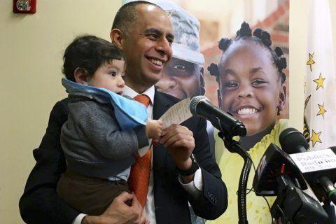 Baby in the office? Providence mayor's habit sparks debate