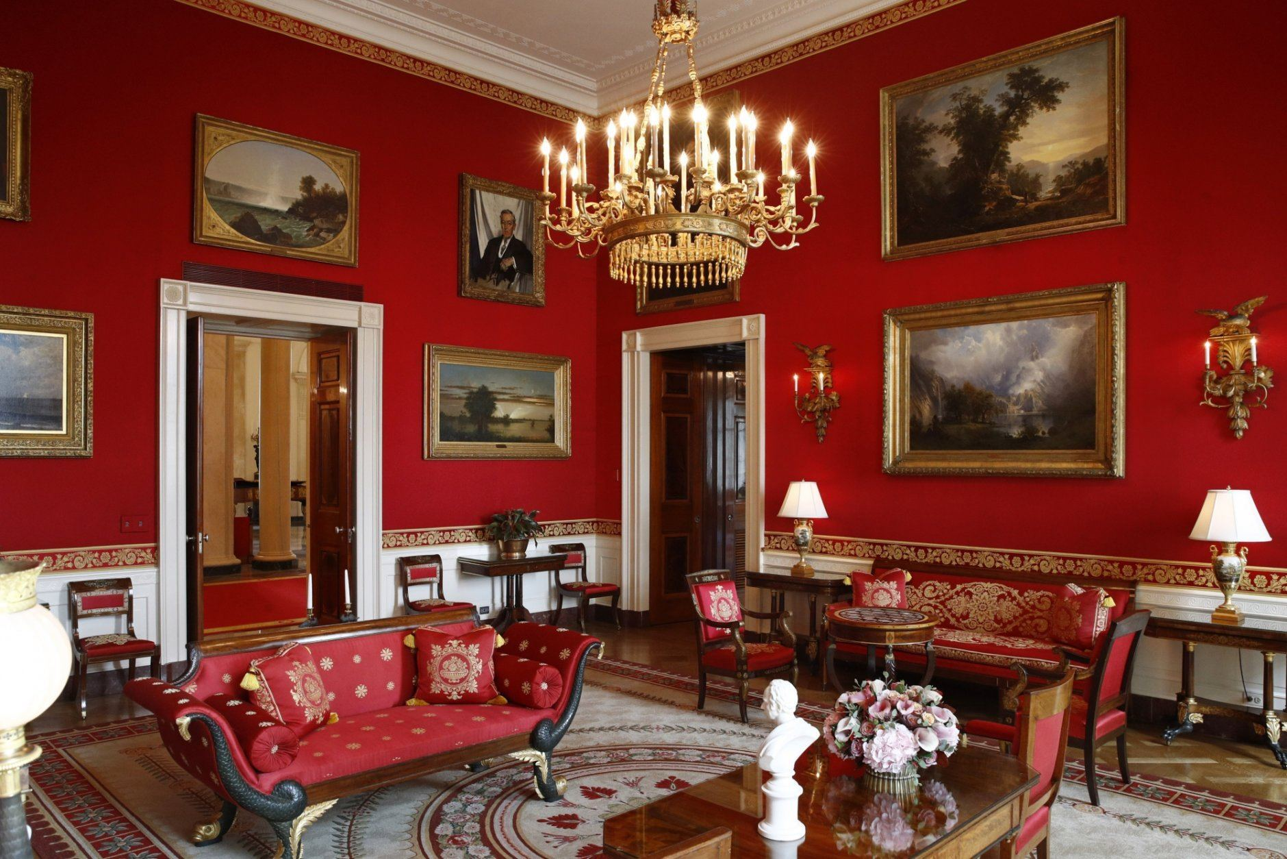 """This Sept. 17, 2019, photo shows refreshed wall fabric in the Red Room of the White House in Washington. Sunlight streaming into the Red Room had left wall fabric """"so faded it was almost pink,"""" said Stewart McLaurin, president of the White House Historical Association. (AP Photo/Patrick Semansky)"""