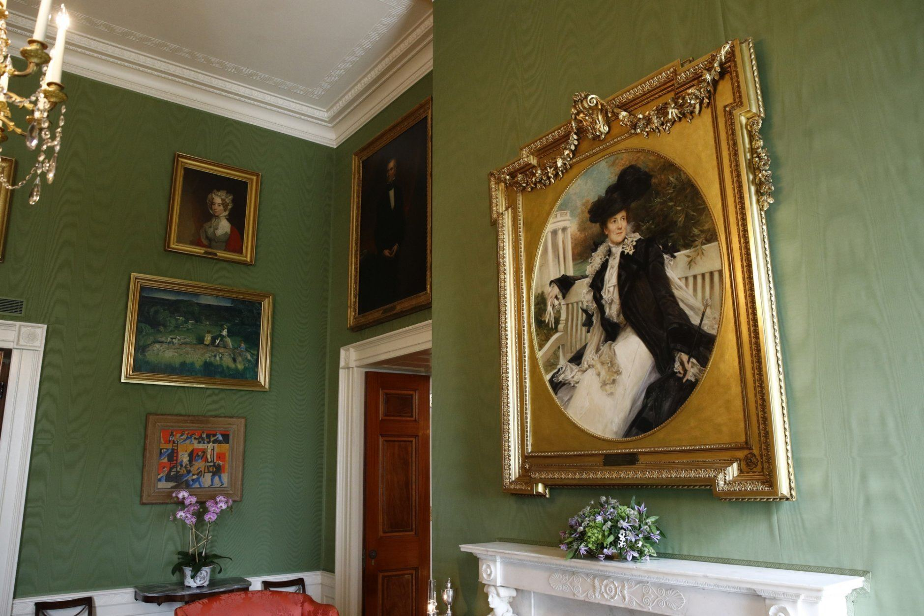 This Sept. 17, 2019, photo shows a portrait of former first lady Edith Roosevelt, right, wife of President Theodore Roosevelt, in the Green Room of the White House in Washington. The portrait was placed in the Green Room as part of the improvement projects first lady Melania Trump has overseen to keep the well-trod public rooms at 1600 Pennsylvania Avenue looking their museum-quality best. (AP Photo/Patrick Semansky)