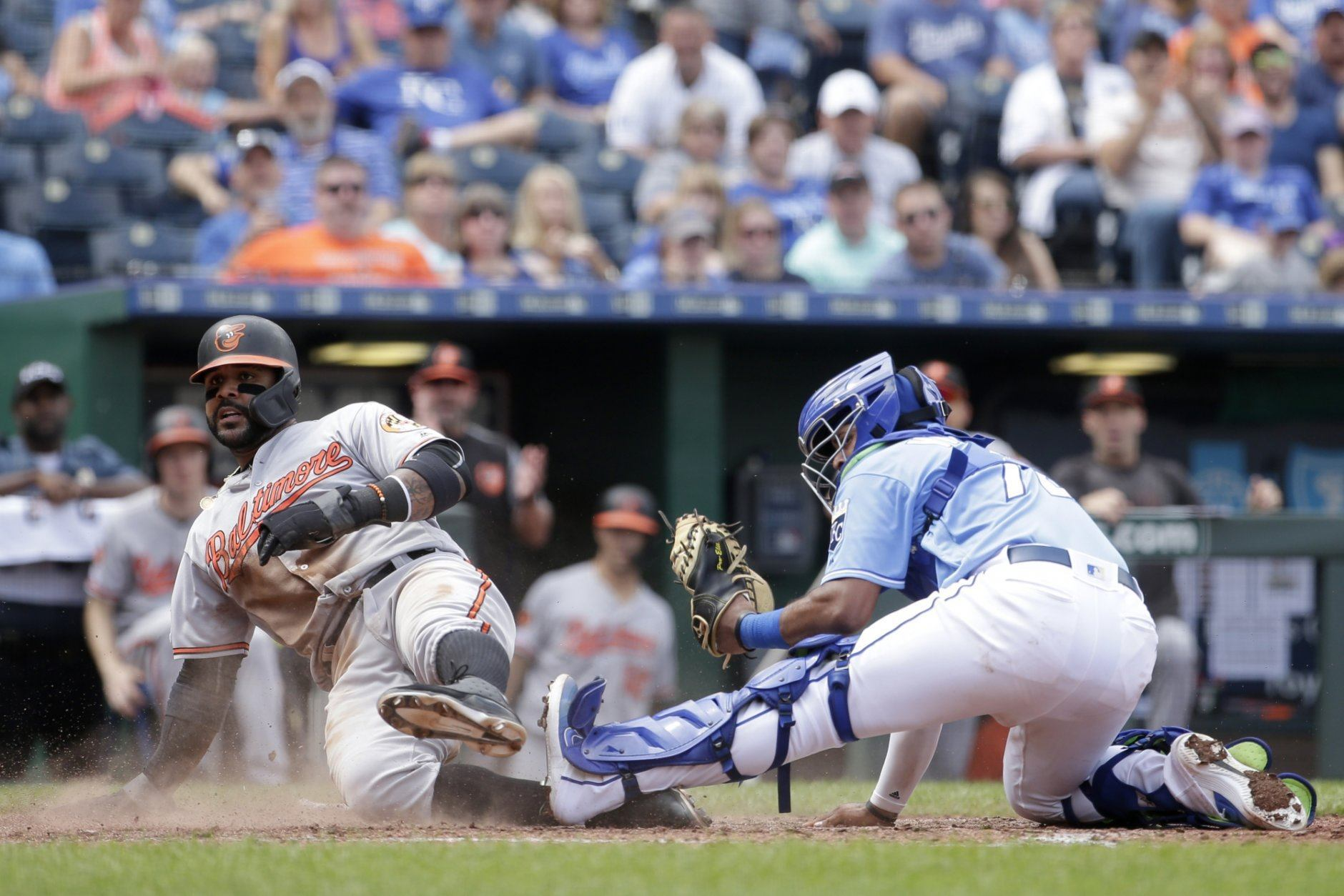 Baltimore Orioles' Jonathan Villar beats the tag by Kansas City Royals catcher Meibrys Viloria to score on a fielders's choice hit into by Pedro Severino during the sixth inning of a baseball game Sunday, Sept. 1, 2019, in Kansas City, Mo. (AP Photo/Charlie Riedel)