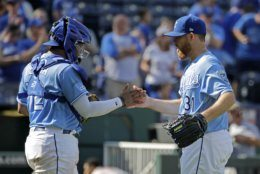 Kansas City Royals relief pitcher Ian Kennedy, right, and catcher Meibrys Viloria celebrate after a baseball game against the Baltimore Orioles, Sunday, Sept. 1, 2019, in Kansas City, Mo. (AP Photo/Charlie Riedel)