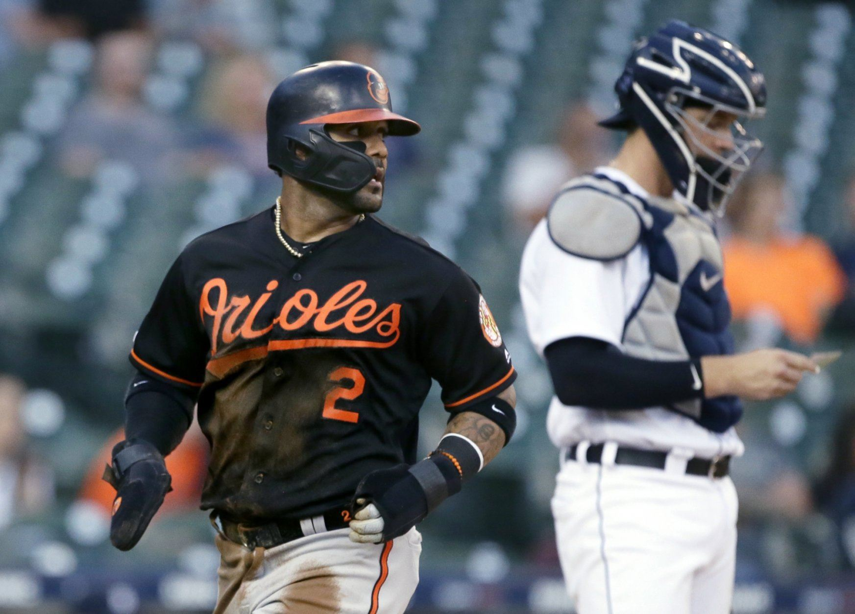 Baltimore Orioles' Jonathan Villar (2) scores past Detroit Tigers catcher Grayson Greiner on a single by Trey Mancini during the first inning of a baseball game Friday, Sept. 13, 2019, in Detroit. (AP Photo/Duane Burleson)