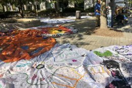 Climate protesters brought decorated parachutes to the area around the Newseum, in D.C., before the beginning of the march.