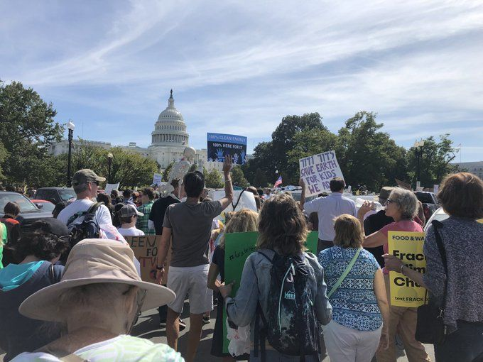 Climate protesters march toward the Capitol, in D.C., Sept. 20, 2019.