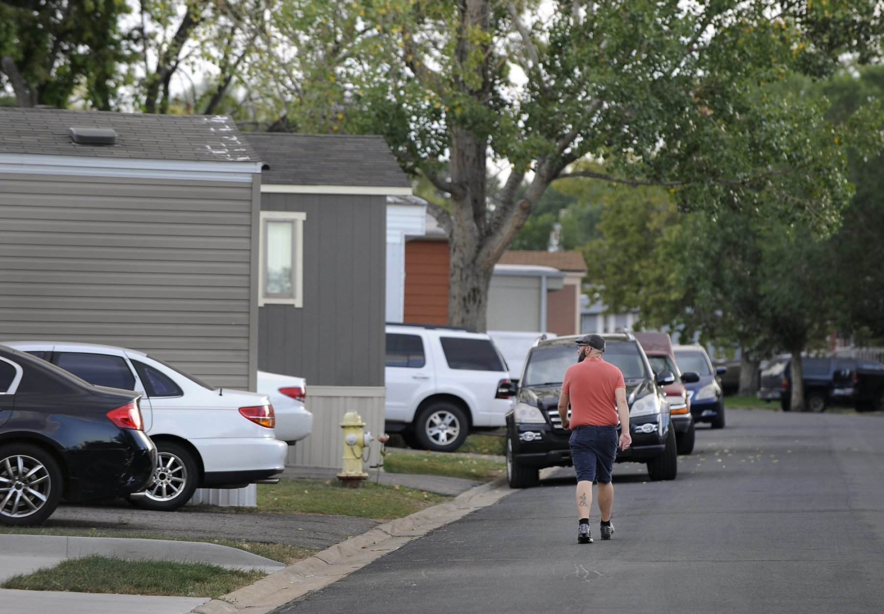 <p>In this Aug. 30th 2019 photo shows residents of Lamplighter Village, a manufactured and mobile home park, spending time outdoors in their community in Federal Heights, Colo. Across Colorado, where the housing crisis impacts both rural and urban towns, the strife between mobile home park residents and park owners approaches a boiling point. The business model &#8212; in which homeowners pay lot rent to park their houses on someone else&#8217;s land &#8212; capitalizes on the immobility and economic fragility of tenants who often can&#8217;t afford to move or live anywhere else.(Kathryn Scott/The Colorado Sun)</p>