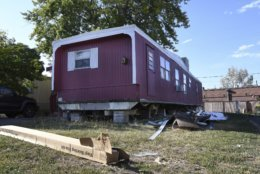 <p>In this Aug. 30th 2019 photo shows a home sitting with a vinyl skirting kit in boxes on the ground, seemingly ready for replacement at Lamplighter Village, a manufactured and mobile home park in Federal Heights, Colo. Across Colorado, where the housing crisis impacts both rural and urban towns, the strife between mobile home park residents and park owners approaches a boiling point. The business model &#8212; in which homeowners pay lot rent to park their houses on someone else&#8217;s land &#8212; capitalizes on the immobility and economic fragility of tenants who often can&#8217;t afford to move or live anywhere else. (Kathryn Scott/The Colorado Sun)</p>