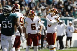 Washington Redskins' Dustin Hopkins, right, reacts after kicking a field goal during the first half of an NFL football game against the Philadelphia Eagles, Sunday, Sept. 8, 2019, in Philadelphia. (AP Photo/Michael Perez)