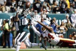 Philadelphia Eagles' DeSean Jackson, left, catches a touchdown pass against Washington Redskins' Josh Norman during the first half of an NFL football game, Sunday, Sept. 8, 2019, in Philadelphia. (AP Photo/Michael Perez)