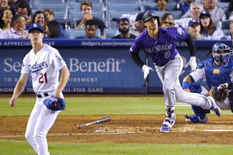 Rockies beat Dodgers 4-2 to end 12-game skid in LA