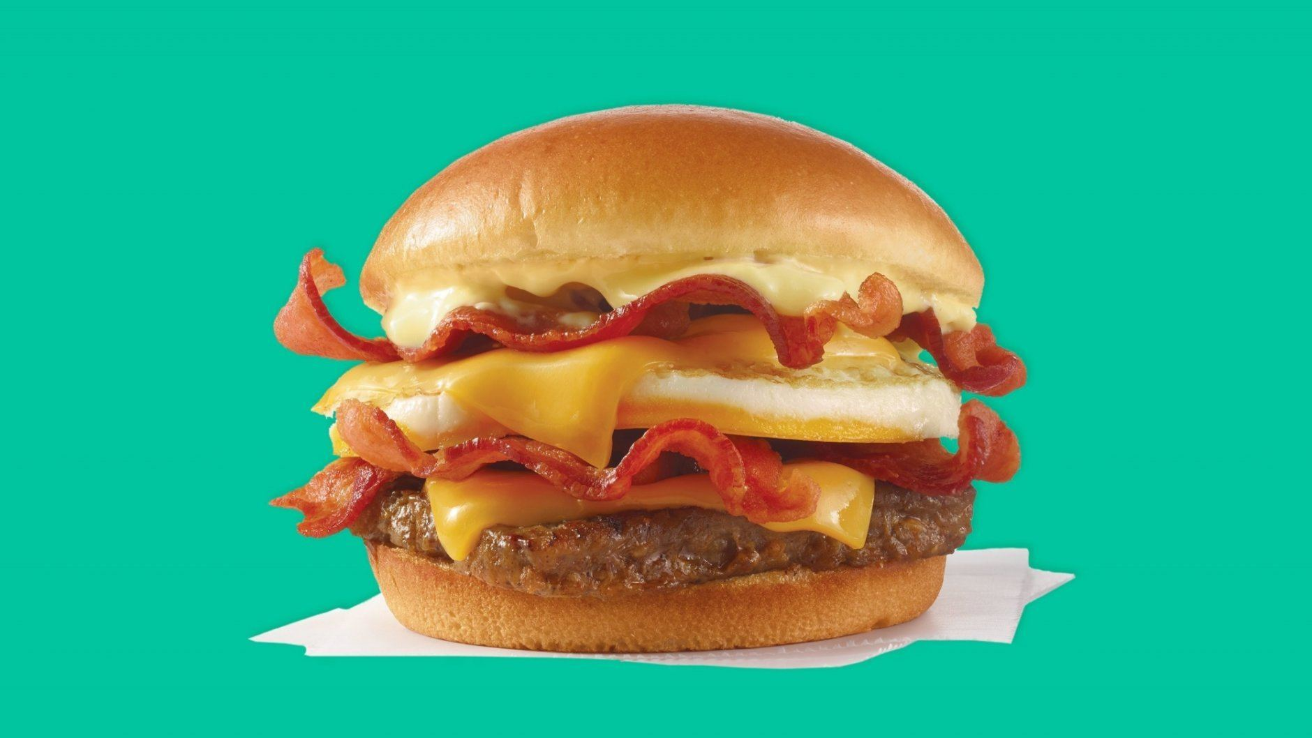 """""""Breakfast Baconator"""" is an egg, several slices of bacon, a sausage patty, two slices of American cheese and a dollop of hollandaise sauce."""