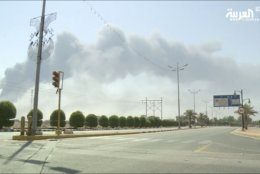 In this image made from a video broadcast on the Saudi-owned Al-Arabiya satellite news channel on Saturday, Sept. 14, 2019, smoke from a fire at the Abqaiq oil processing facility can be seen in Buqyaq, Saudi Arabia. Drones launched by Yemen's Houthi rebels attacked the world's largest oil processing facility in Saudi Arabia and another major oilfield Saturday, sparking huge fires at a vulnerable chokepoint for global energy supplies. (Al-Arabiya via AP) TV OUT NO SALES