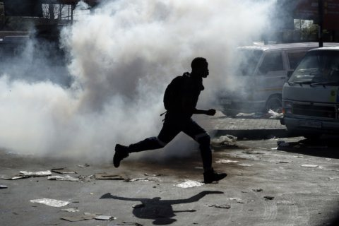South African police arrest 90 as unrest in cities continues