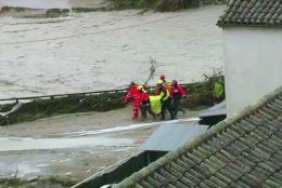 In this image made from video provided by Atlas, emergency services carry an injured woman on a stretcher, in Ontiyente, Spain, Thursday, Sept. 12 2019.  A large area of southeast Spain was battered Thursday by what was forecast to be its heaviest rainfall in more than a century, with the storms wreaking widespread destruction and killing at least two people. (Atlas via AP)
