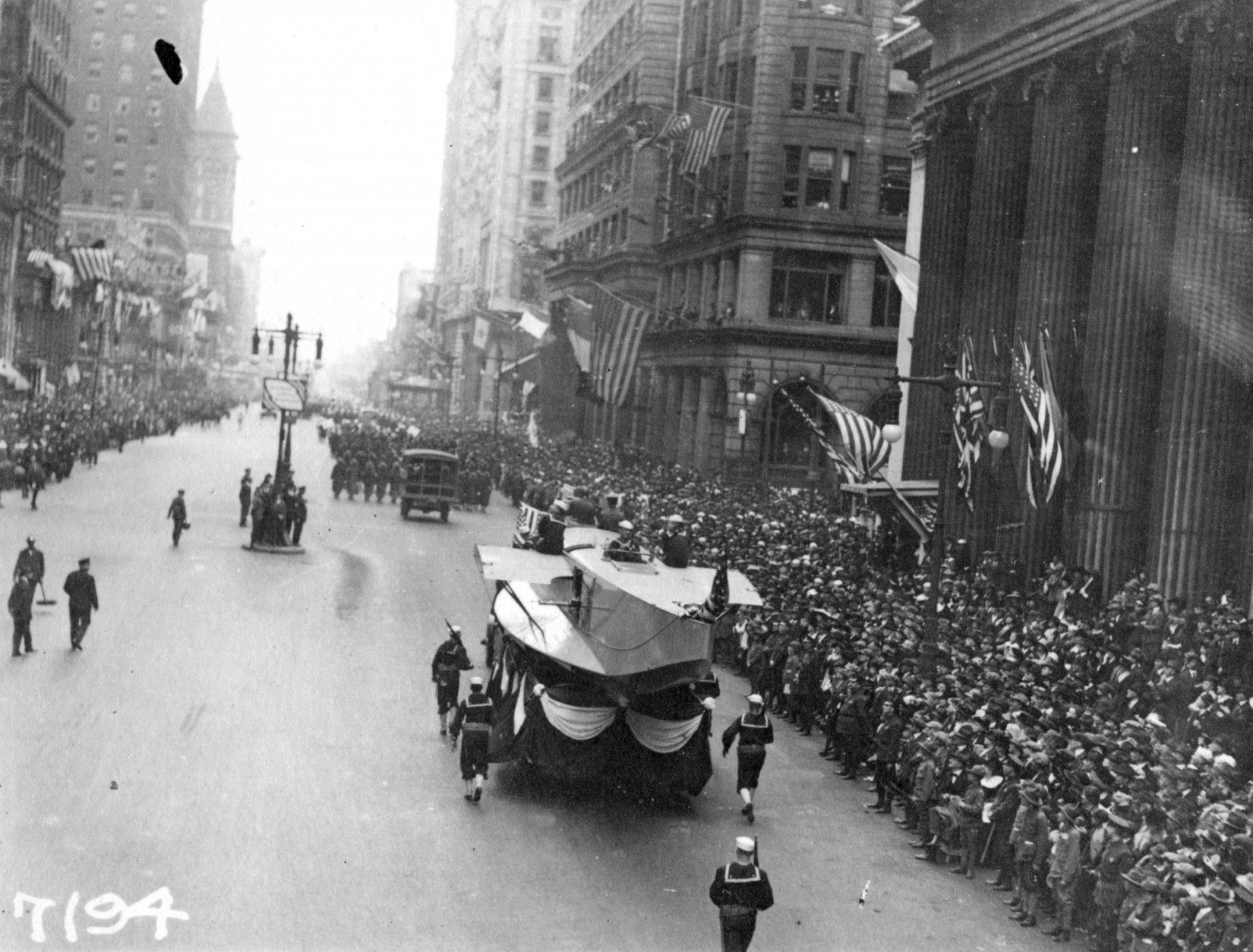 In this Sept. 28, 1918 photo provide by the U.S. Naval History and Heritage Command the Naval Aircraft Factory float moves south on Broad Street escorted by Sailors during the a parade meant to raise funds for the war effort, in Philadelphia. The Mutter Museum will present a parade on Saturday Sept. 28, featuring about 500 members of the public, four illuminated floats and an original piece of music as a sort of moving memorial to the 1918-1919 influenza pandemic. (U.S. Naval History and Heritage Command via AP)