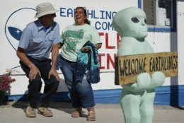 "Little A'Le'Inn owner Connie West, right, laughs with Kirk Schultz outside of the bar and restaurant, Wednesday, Sept. 18, 2019, in Rachel, Nev. The the two were helping to prepare for upcoming events spawned from the ""Storm Area 51"" internet hoax. (AP Photo/John Locher)"