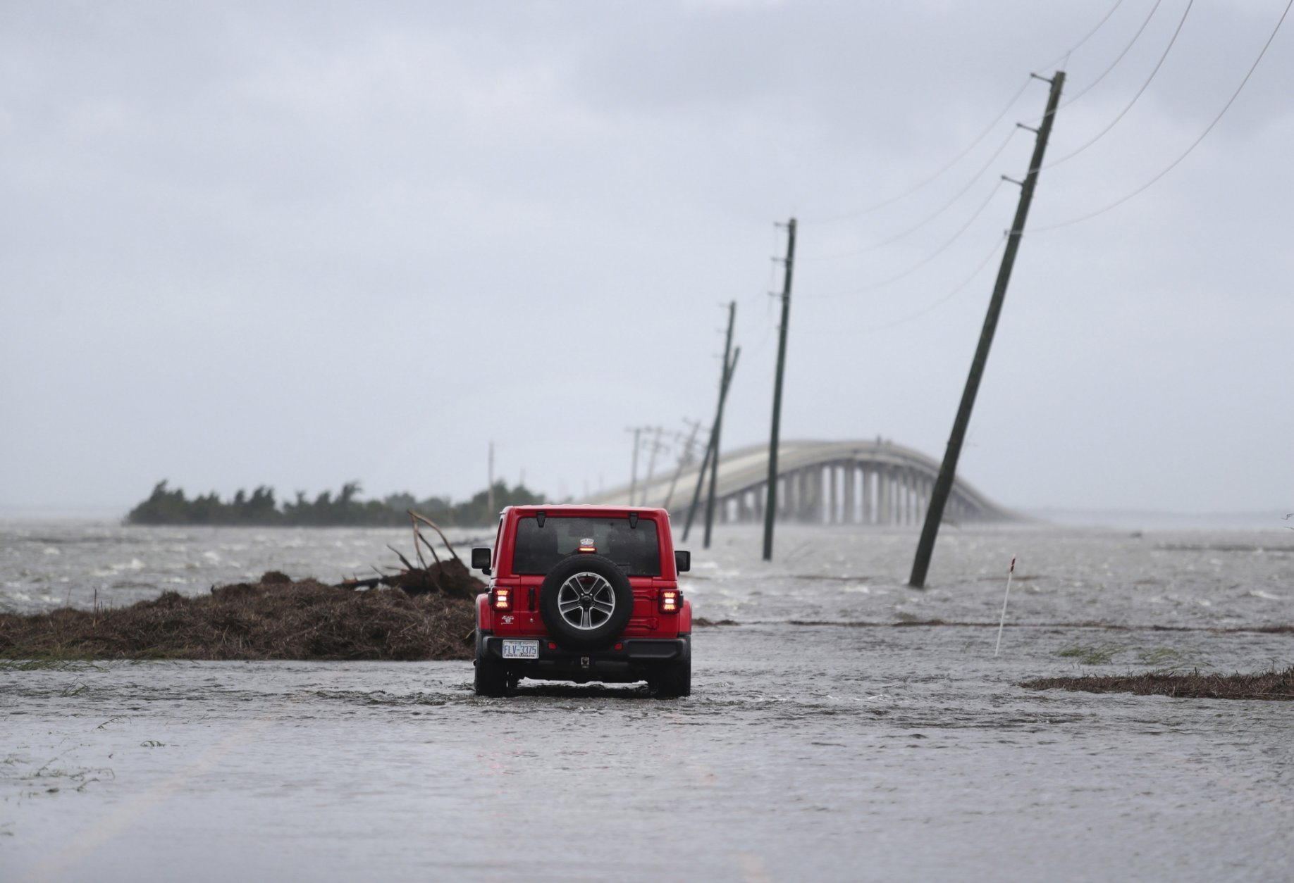 Storm surge from Hurricane Dorian blocks Cedar Island off from the mainland on NC 12 in Atlantic, N.C., after Hurricane Dorian past the coast on Friday, Sept. 6, 2019. (AP Photo/Tom Copeland)
