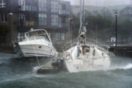 Waves crash into boats long the waterfront in Halifax, Nova Scotia  as hurricane Dorian approaches on Saturday, Sept. 7, 2019.  Weather forecasters say Hurricane Dorian is picking up strength as it approaches Canada.  (Andrew Vaughan/The Canadian Press via AP)