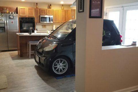 Florida man parks Smart car in kitchen so it won't blow away