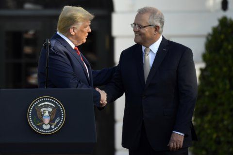 The Latest: Americans, Australians celebrate in Rose Garden
