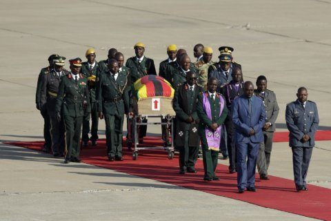 Mourning for Zimbabwe's Mugabe marred by dispute, stampede