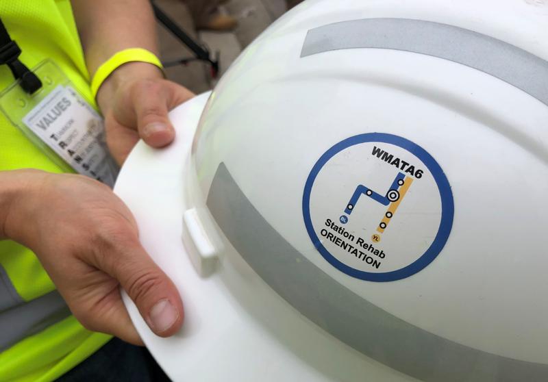 Project logo on construction worker's helmet