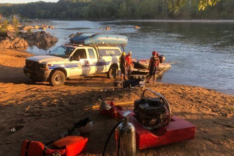 Park service, firefighters monitor fire on an island in the middle of the Potomac River